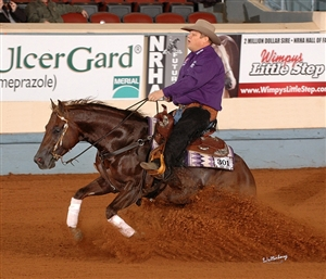 Hendricks and Cache Of Jewels (by Conquistador Whiz )Take the Lead at the NRHA Futurity